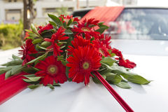 Bouquet of flowers on wedding car. Bouquet of red flowers on wedding car Royalty Free Stock Image