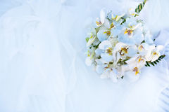 Bouquet of flowers and wedding dress Stock Image