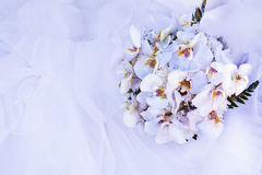 Bouquet of flowers and wedding dress Stock Photo