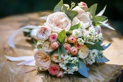 Bouquet of flowers. Wedding bouquet of flowers on a wooden deck royalty free stock image