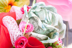 Bouquet of flowers in white background made from currency baht Royalty Free Stock Photography