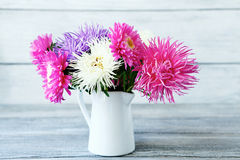 Bouquet of flowers in white jug Royalty Free Stock Image