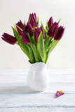 Bouquet of flowers in a white vase stock photo