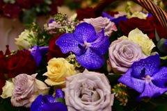 Bouquet of flowers in wicker basket stock photos