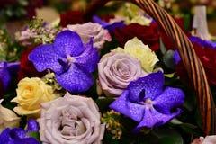 Bouquet of flowers in wicker basket stock photo