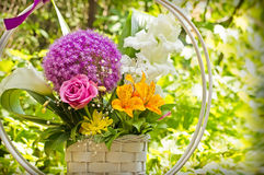 Bouquet of flowers in wicker basket Royalty Free Stock Photos