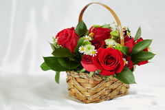Bouquet of flowers in wicker basket Stock Photography