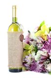 Bouquet flowers and wine Stock Photos