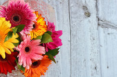 Bouquet of flowers on a wooden background Royalty Free Stock Image