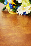Bouquet of flowers on a wooden surface Stock Images