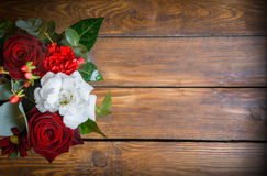 Bouquet of flowers on a wooden table Stock Photos