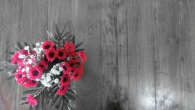 Bouquet of flowers on wooden table stock photography