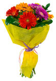 Bouquet of flowers in yellow package Stock Photos