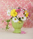 Bouquet of flowersin the green vase Stock Image