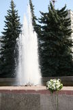 The Bouquet beside fountain. The Bouquet lies near by fountain. This photo is not correction Stock Photography