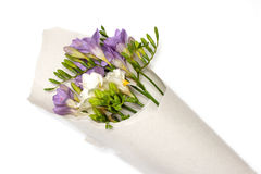 Bouquet of freesia in the paper Royalty Free Stock Images
