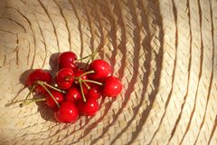 A bouquet of fresh cherries in a sun hat. A bouquet of fresh cherries in a sun hat Stock Photos