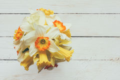 Bouquet of fresh flowers of daffodils on a white wooden background with space for text Stock Photo