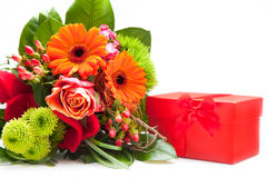 Bouquet of Fresh Flowers and Red Gift Box Stock Photography