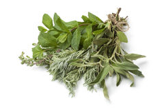 Bouquet of fresh Moroccan herbs. On white background Stock Photo