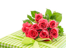 Bouquet of fresh pink roses with gift isolated on white Royalty Free Stock Images