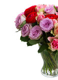 Bouquet of fresh roses and ranunculus. Bouquet of roses and ranunculus  in glass vase close up  isolated on white background Royalty Free Stock Images