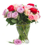 Bouquet of fresh roses and ranunculus. Bouquet of roses and ranunculus  in glass vase isolated on white background Royalty Free Stock Photo