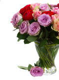 Bouquet of fresh roses and ranunculus. Bouquet of rose and ranunculus flowers in vase close up isolated on white background Stock Photography