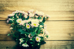 Bouquet of fresh spring flowers on rustic wood. Vintage Stock Images