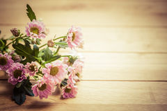 Bouquet of fresh spring flowers on rustic wood. Vintage Stock Image
