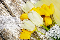 Bouquet of fresh spring tulip flowers on white wooden background. Fresh spring tulip flowers on wooden background Stock Image