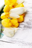 Bouquet of fresh spring tulip flowers on white wooden table Stock Photos