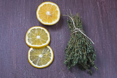Bouquet of fresh thyme and lemon Stock Images