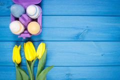 Bouquet of fresh tulips and Easter eggs wrapped woolen string, Easter decoration, copy space for text Stock Image