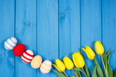 Bouquet of fresh tulips and Easter eggs wrapped woolen string, Easter decoration, copy space for text Royalty Free Stock Images
