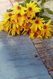 Bouquet of fresh yellow flowers on wooden background Royalty Free Stock Photos