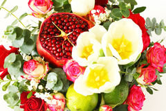Bouquet with fruit and flowers Stock Image
