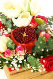 Bouquet with fruit and flowers Stock Images