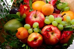 Bouquet of fruits and flowers royalty free stock photo