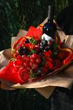 The bouquet of fruits and wine royalty free stock images