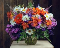 Bouquet of garden flowers in a glass jug Royalty Free Stock Photo