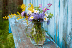 Bouquet of garden flowers and healing herbs Stock Photo