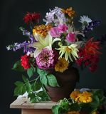 Bouquet of garden flowers in a jug. Royalty Free Stock Photo