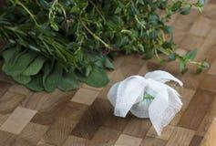 Bouquet Garni. A Bouquet Garni Muslin Sachet And Fresh Herbs On A Wooden Chopping Block Stock Photography