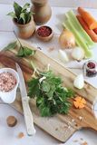 Bouquet garnish from fresh aromatic herbs and raw vegetables. On the wooden cutting board Stock Photo