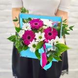 Bouquet of gentle flowers in blue woodwn box stock image