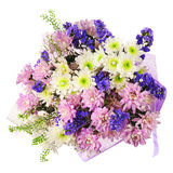 Bouquet of gerbera, carnations and other flowers in blue package Stock Photography
