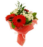 Bouquet of gerbera flowers in red packaging isolated on white Stock Photo