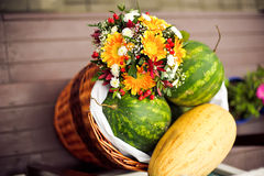 Bouquet of gerberas, melons Stock Photography