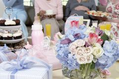 Bouquet And Gifts On Table At A Baby Shower Royalty Free Stock Images